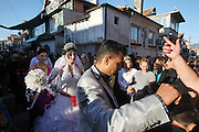 A wedding in the Hossein family. At Nadeshjda Mahala, a vast Roma district on the edge of Sliven Bulgaria..Roma Gypsies left India 1000 years ago. Often nomadic. A collection of tribes with their own languages and culture, pushed by the Ottoman empire towards Europe, used and sold as mercenaries, slaves, prostitutes. They endured 500 years of slavery until mid 19th century. A million were killed in the holocaust. Hundreds of thousands exiled and refugees from kosovo. Many Eastern Europe Roma come to the west seeking a better life. They are shunned, marginalized, excluded. Both indigenous and foriegn Roma, whether European citizens or not, lack the opportunities of others, living on the periphery, in the brunt of racism, often deported back to their countries of origin.