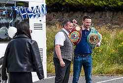Josh Taylor victory tour, Prestonpans, East Lothian, Scotland, United Kingdom 27 June 2021: <br /> Prestonpans born world boxing champion Josh Taylor greets his fans from an open top white double decker bus in a victory lap around the town. Josh Taylor became the first  British boxer world champion in the four-belt era after defeating Jose Ramirez last month. Pictured: Josh with two of his belts.<br /> Sally Anderson | EdinburghElitemedia.co.uk