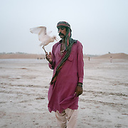 People from the Mohana tribe use to live on the Manchar lake. But now there are no fish due to climate change and pollution. In the city of Sehwan Sharif