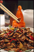 Stir-fried silkworm pupae about to be eaten, Guangzhou, China. Silk worm pupae can also be deep-fried. (Man Eating Bugs page 91).