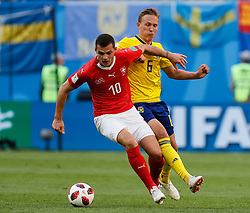 July 3, 2018 - Saint Petersburg, Russia - Ludwig Augustinsson (R) of Sweden national team and Granit Xhaka of Switzerland national team vie for the ball during the 2018 FIFA World Cup Russia Round of 16 match between Sweden and Switzerland on July 3, 2018 at Saint Petersburg Stadium in Saint Petersburg, Russia. (Credit Image: © Mike Kireev/NurPhoto via ZUMA Press)