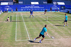 LIVERPOOL, ENGLAND - Sunday, June 24, 2018: Adam Jones (GBR) and Robert Kendrick (USA) during their doubles match against Neal Skupski (GBR) and Ken Skupski (GBR) on day four of the Williams BMW Liverpool International Tennis Tournament 2018 at Aigburth Cricket Club. (Pic by Paul Greenwood/Propaganda)