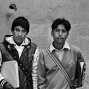 Raul Flores Quispe, 16, (left) and Alex Adolfo Choque, 15,  Students. Potosi. Bolivia..Sitting at 4,090M (13,420 Feet) above sea level the small mining community of Potosi, Bolivia is one of the highest cities in the world by elevation and sits ?sky high? in the hills of the land locked nation. Overlooking the city is the infamous mountain, Cerro Rico (rich mountain), a mountain conceived to be made of silver ore. It was the major supplier of silver for the spanish empire and has been mined since 1546, according to records 45,000 tons of pure silver were mined from Cerro Rico between 1556 and 1783, 9000 tons of which went to the Spanish Monarchy. The mountain produced fabulous wealth and became one of the largest and wealthiest cities in Latin America. The Extraordinary riches of Potosi were featured in Maguel de Cervantes famous novel Don Quixote. One theory holds that the mint mark of Potosi, the letters PTSI superimposed on one another is the origin of the dollar sign. Today mainly zinc, lead, tin and small quantities of silver are extracted from the mine by over 100 co-operatives and private mining companies who still mine the mountain in poor working conditions, children are still used in the mines and the lack of protective equipment and constant inhalation of dust means miners have a short life expectancy with many contracting silicosis and dying around 40 years of age. UNESCO designated the historic city a World Heritage site in 1987. Most of Potosí's colonial churches have been restored, and tourism has increased. Potosi, Bolivia. 16th September 2011. Photo Tim Clayton