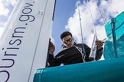 Yassir Al Rahbi (OMA) prepares the main before hoisting. Oman Sail's MOD70 Musandam during Kiel week 2014, 22-06-2014, Kiel - Germany.