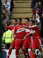 Photo: Lee Earle.<br /> Reading v Middlesbrough. The Barclays Premiership. 19/08/2006. Middlesbrough's Stewart Downing (2ndR) is congratulated after scoring their opening goal.