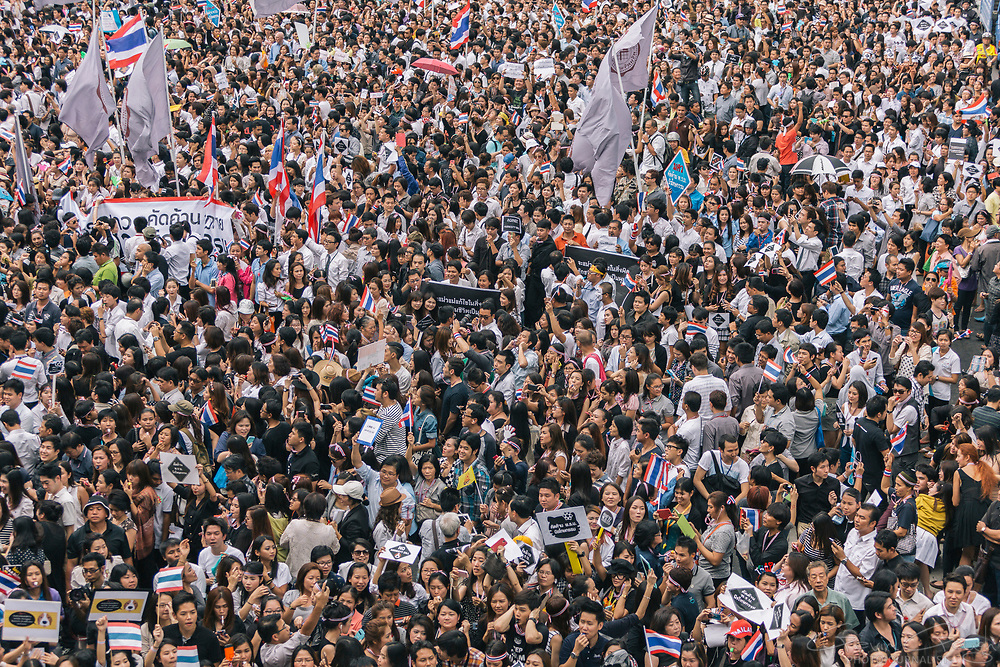 """Anti-Government protesters demonstrate against a proposed """"Amnesty Bill"""" which could overturn the conviction of former Prime Minister Thaksin Shinawatra."""