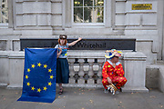 Anti-Brexitcampaigners, including a man dressed as a clown impersonating Prime Minister Boris Johnson, outside the Cabinet Office on Whitehall on the 29th August 2019 in London in the United Kingdom. A group gather outside the Cabinet Office, protesting against British Prime Minster Boris Johnson's announcement of a suspension of Parliament.