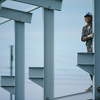 China, Hong Kong, Steel worker at construction site in New Territories