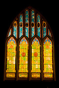 Stained glass windows at night at Wai'oli Hui'ia Church, Hanalei, Island of Kauai, Hawaii