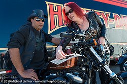 """Bill and Christine O'Connell of Port Orange, FL check out a """"48"""" Sportster at the Harley-Davidson display during Daytona Bike Week. , FL., USA. March 8, 2014.  Photography ©2014 Michael Lichter."""