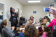 Garden City, New York, USA. 17th April 2016. JON BAUMAN, 'BOWZER', 69, (standing at left) who was singer in the band Sha Na Na, lifts his arm and shouts in deep voice in signature Bowzer character style, when he speaks to a roomful of volunteers working at the Canvass Kickoff for Democratic presidential primary candidate Hillary Clinton at the Nassau County Democratic Office. Bauman spoke about why it's important to GOTV, Get Out The Vote for Hillary Clinton. Bauman is an activist in electoral politics and public policy activist and co-founded Senior Votes Count, which focuses on senior issues.