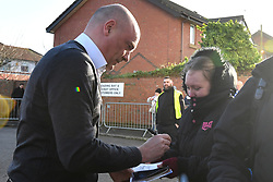 Fleetwood Town manager Uwe Rosler signs autographs for fans prior to the match