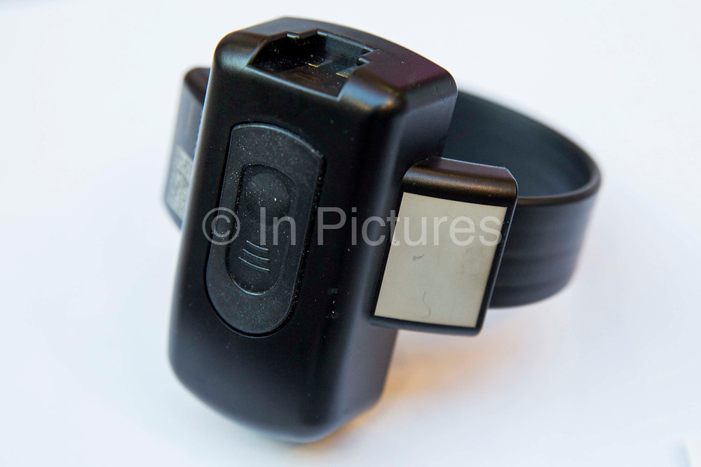 The device worn around the ankle of a prisoner who has been released early to be on a Home Detention Curfew. The base unit is set up in the house and constantly checks if the wearer is present during curfew hours.  Electronic monitoring known as 'tagging' is used in England and Wales to monitor curfews and conditions of a court or prison order.