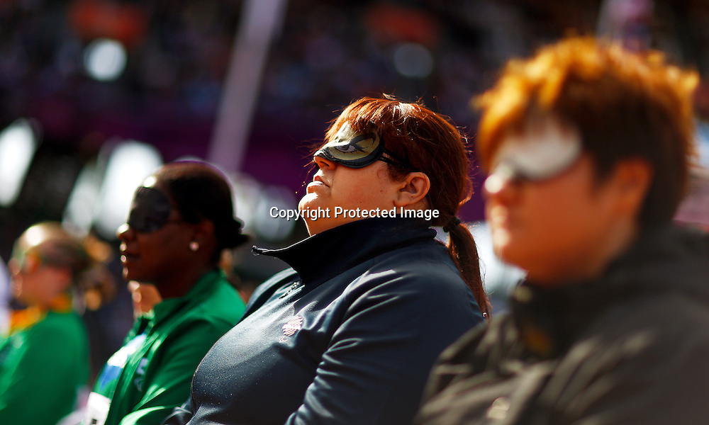 Assunta Legnante (C) of Italy is flanked by Izabela Campos (L) of Brazil and Zhang Liangmin (R) of China at the athletes seats during the women's Shot Put F11/12 final at the Olympic Stadium during the London 2012 Paralympic Games in London, Britain, 05 September 2012. Legnante won the gold medal, Zhang Liangmin took bronze.  EPA/KERIM OKTEN