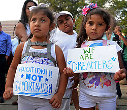 September 5, 2017 - Charlotte, NC, USA - Shendele Melchor, left, Kenny Salazar, center, and Alexa Salazar, right, join a rally on Tuesday, Sept. 5, 2017, at Marshall Park in Charlotte, N.C., following the announcement that DACA is being rescinded with a ''wind down'' period. (Credit Image: © Jeff Siner/TNS via ZUMA Wire)