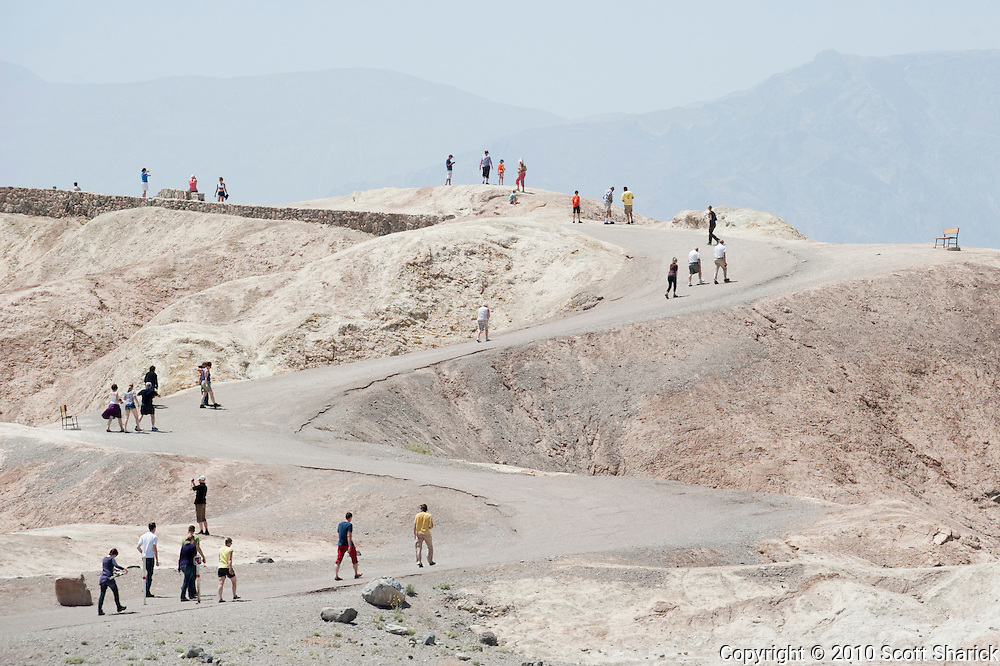 People walking along the curved path to Zabriskie Point in Death Valley National Park in California