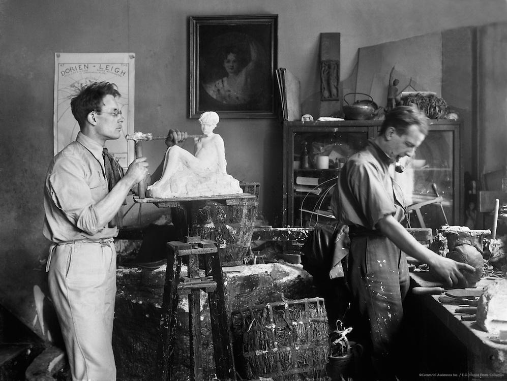 Inman Knox, sculptor, at work in the studio, England, 1921