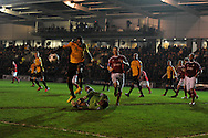 Wrexham keeper Joslain Mayebi dives to save from Newport's Aaron O'Connor.Blue Square Bet Premier division, Newport County FC v Wrexham at Rodney Parade in Newport, South Wales on Friday 4th Jan 2013. pic by Andrew Orchard, Andrew Orchard sports photography,