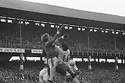 Three players collide mid air as they go for the ball during the All Ireland Minor Gaelic Football Final, Tyrone v Kerry in Croke Park on the 28th September 1975.