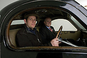 Found in a garage where it had been stored virtually untouched for 50 years, this 1937 Bugatti Type 57s Atalante sports car is previewd for the first time before a Bonhams auction in Paris on February 7th 2009. Phoenix Green Garage Studio owner and vintage car restorer Nick Benwell (L) with auctioneers Bonhams International Managing Director of the Motor Car Department, James Knight (R).