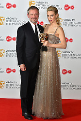 John Simm with Vanessa Kirby and her BAFTA award for Supporting Actress at the Virgin TV British Academy Television Awards 2018 held at the Royal Festival Hall, Southbank Centre, London.