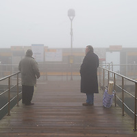 "VENICE, ITALY - JANUARY 05: Passengers wait for a ""Vaporetto"" (Waterbus) as thick fog shrouds the city, on January 5, 2012 in Venice, Italy. Venice woke up this morning under a heavy blanket of fog adding to the atmosphere of the city."