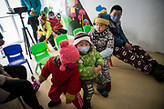 Children suffering from cancer gather in a playroom run by a local NGO in the Wujianong neighborhood of Hefei, China, on Thursday, Nov. 26, 2015. Cheap housing in the neighbourhood and its closeness to the regional children hospital has made it a popular long term stay option for many families with kids suffering from caner, notably Leukaemia, as Surging health-care costs are turning into one of the biggest threats to the world's second largest economy and its consumers. Surging health-care costs are turning into one of the biggest threats to the world's second largest economy and its consumers.