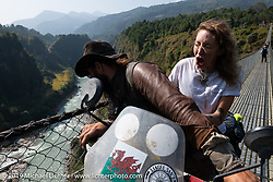Talk Shop Podcaster Danger Dan did an amazing job riding Danita Gayle 2-up on roads not meant for 2-up riding after she took a spill and needed some time off her leg on Motorcycle Sherpa's Ride to the Heavens motorcycle adventure in the Himalayas of Nepal. Danita let it be known (to the world) that she didn't much appreciate the bridge crossings. On the sixth day of riding, we went from Tatopani to Pokhara. Saturday, November 9, 2019. Photography ©2019 Michael Lichter.