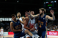 SPAIN, Madrid: Real Madrid's Greek player Ioannis Bourousis,Ucam Murcia´s Montenegrin player Nemanja Radovicduring and Ucam Murcia´s Brazilian player Raul Togni Neto during the Liga Endesa Basket 2014/15 match between Real Madrid and Ucam Murcia, at Palacio de los Deportes in Madrid on November 16, 2014.