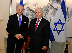 Foreign Affairs Minister Laurent Fabius and Israeli President Shimon Peres shake hands at the end of their meeting at the Shangri La hotel in Paris, France, on March 11, 2013. Photo by Mousse/ABACAPRESS.COM