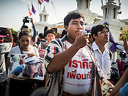 07 JULY 2015 - BANGKOK, THAILAND:  Student activist  SIRIWIT SERITHIWAT leads a group of democracy advocates to the Ministry of Defense before a rally at the MoD. About 100 people gathered in front of the Ministry of Defense in Bangkok Tuesday to support 14 university students arrested two weeks ago for violating orders against political assembly. They're facing criminal trial in military courts. The courts ordered their release Tuesday because they can only be held for two weeks without trial, the two weeks expired Tuesday and the military court chose not to renew their pretrial detention. The court order was not an acquittal. They still face trial and possible prison sentences if convicted.       PHOTO BY JACK KURTZ