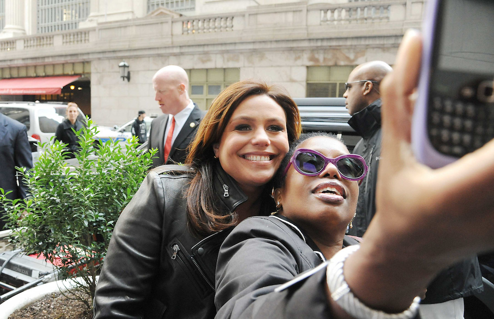 """Rachael Ray is seen with the $2 Buck Food Truck in a photo from the production of """"The Rachael Ray Show"""" in New York City on November 3, 2011. David E. Steele/Disney/ABC"""