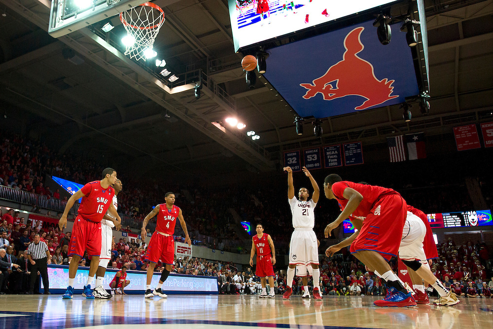 DALLAS, TX - JANUARY 4: Omar Calhoun #21 of the Connecticut Huskies shoots a free-throw against the SMU Mustangs on January 4, 2014 at Moody Coliseum in Dallas, Texas.  (Photo by Cooper Neill) *** Local Caption *** Omar Calhoun