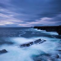 Stormy seas crash against dramatic coastal cliffs at Yesnaby, Orkney, Scotland