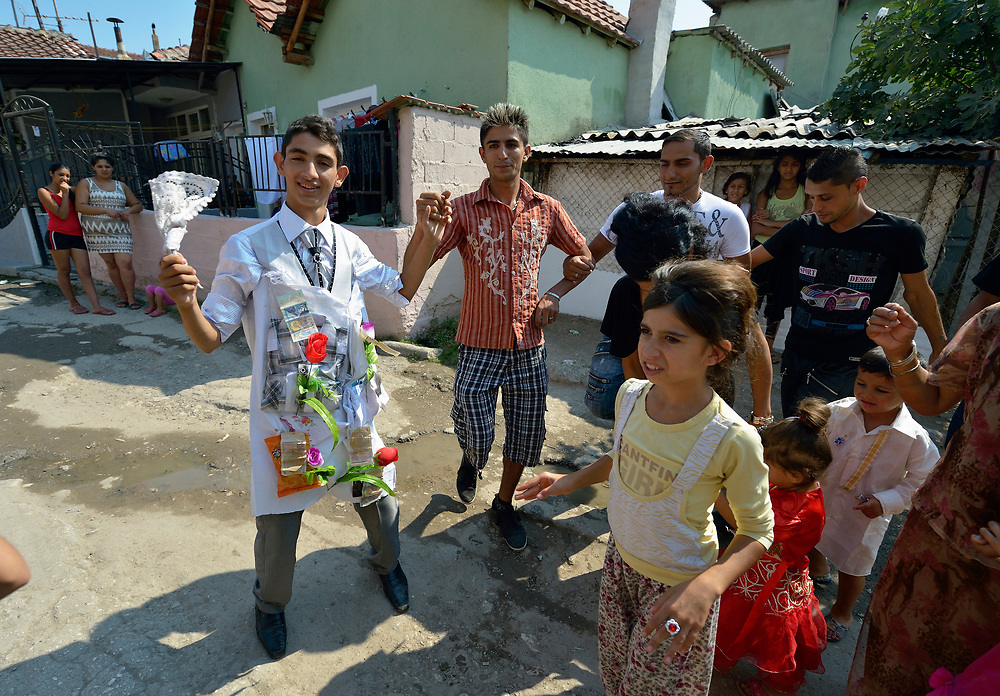 The groom and his friends dance in a wedding in Suto Orizari, Macedonia. The mostly Roma community, located just outside Skopje, is considered Europe's largest Roma settlement. .