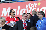 Cardiff city owner Vincent Tan keeps an eye on his team from the stand. Barclays Premier league, Cardiff city v Everton at the Cardiff city Stadium in Cardiff,  South Wales on Saturday 31st August 2013. pic by Andrew Orchard,  Andrew Orchard sports photography,