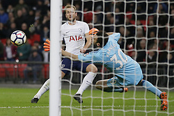 BRITAIN-LONDON-FOOTBALL-PREMIER LEAGUE-TOTTENHAM HOTSPUR VS WATFORD.(180430) -- LONDON, April 30, 2018  Watford's Orestis Karnezis (R) attempts to save Tottenham Hotspur's Harry Kane's shot which went wide during the Premier League football match between Tottenham Hotspur and Watford at Wembley Stadium in London, Britain on April 30, 2018.  Tottenham Hotspur won 2-0.  FOR EDITORIAL USE ONLY. NOT FOR SALE FOR MARKETING OR ADVERTISING CAMPAIGNS. NO USE WITH UNAUTHORIZED AUDIO, VIDEO, DATA, FIXTURE LISTS, CLUB/LEAGUE LOGOS OR ''LIVE'' SERVICES. ONLINE IN-MATCH USE LIMITED TO 45 IMAGES, NO VIDEO EMULATION. NO USE IN BETTING, GAMES OR SINGLE CLUB/LEAGUE/PLAYER PUBLICATIONS. (Credit Image: © Tim Ireland/Xinhua via ZUMA Wire)