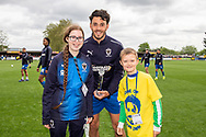 AFC Wimbledon Defender Will Nightingale (5) receives an award during the EFL Sky Bet League 1 match between AFC Wimbledon and Wycombe Wanderers at the Cherry Red Records Stadium, Kingston, England on 27 April 2019.