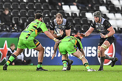 Ospreys' Alun Wyn Jones is tackled by Northampton Saints' David Ribbans<br /> <br /> Photographer Craig Thomas/Replay Images<br /> <br /> EPCR Champions Cup Round 4 - Ospreys v Northampton Saints - Sunday 17th December 2017 - Parc y Scarlets - Llanelli<br /> <br /> World Copyright © 2017 Replay Images. All rights reserved. info@replayimages.co.uk - www.replayimages.co.uk