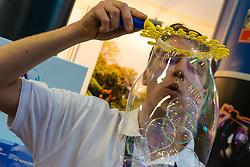 A man blows bubbles into a giant bubble the Toy Fair at Kensington Olympia in London, the UK's largest dedicated game and hobby exhibition featuring the hottest and most anticipated products for the year ahead. London, January 22 2019.