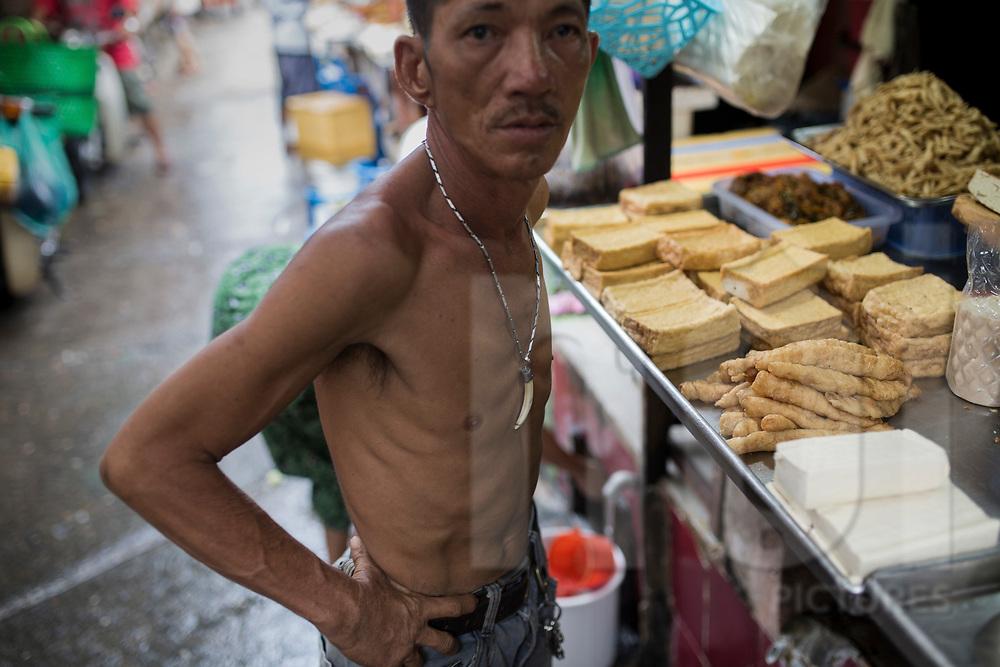 Vietnamese man wearing a teeth necklace, Ho Chi Minh City, Vietnam, Southeast Asia