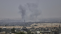 June 21, 2017 - Mosul, Iraq - An explosion close to the leaning minaret of the Al-Nouri Mosque that was destroyed later the same day. The minaret was still standing after the explosion. Mosul, Iraq 21 June 2017  (Credit Image: © Noe Falk Nielsen/NurPhoto via ZUMA Press)