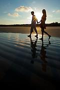 Ad campaign: Couple walking on Praia Grande beach on Ilha do Mel, Brazil