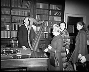 "Presentation of Harp to President DeValera..1972..29.12.1972..12.29.1972..29th December 1972..Mrs Julia Fennell presented a harp to President DeValera as a gift to Áras an Uachtaráin. She presented the harp on behalf of her late husband Mr Thomas J Fennell and herself..The harp was manufactured in 1835 at the firm of Robinson and Russell,westmoreland Street,Dublin. the harp is 36ins high and has 33 strings. It will be retained in an exhibition case bearing the inscription ""Tomas O'Fionnghaill agus Sile Ui Fhionnghail,Baile Atha Cliath, a bhronn ar Áras an Uachtaráin,1972"".(Presented to Áras an Uachtaráin by Thomas and Julia Fennell,Dublin 1972)..Image shows President DeValera accepting the harp from Mrs Julia Fennell who was accompanied by her daughters Dr Geraldine Fennell and Ms Rosemary Fennell."