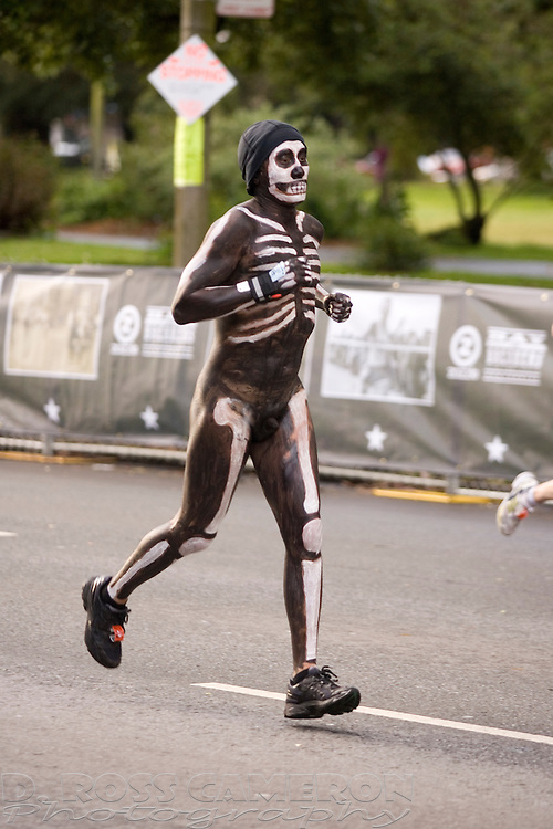 A man in body paint runs along Fell Street during the 100th running of the Bay to Breakers 12K, Sunday, May 15, 2011 in San Francisco. (Photo by D. Ross Cameron)