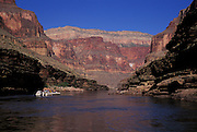 View down Conquistador Aisle at sunrise, rafters on river. Grand Canyon National Park, Arizona..Subject photograph(s) are copyright Edward McCain. All rights are reserved except those specifically granted by Edward McCain in writing prior to publication...McCain Photography.211 S 4th Avenue.Tucson, AZ 85701-2103.(520) 623-1998.mobile: (520) 990-0999.fax: (520) 623-1190.http://www.mccainphoto.com.edward@mccainphoto.com.