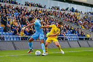 Oxford United midfielder Cameron Brannagan (8) tackles Coventry City defender Jordan Willis (4)  during the EFL Sky Bet League 1 match between Oxford United and Coventry City at the Kassam Stadium, Oxford, England on 9 September 2018.