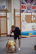 Katie Ormerod with gymnastic coach Ross Hill at the Leeds Gymnastic Club on 21st July 2017 in Leeds, United Kingdom. Leeds Gymnastic Club is one of the training facilities for the GB Snow team in the UK.