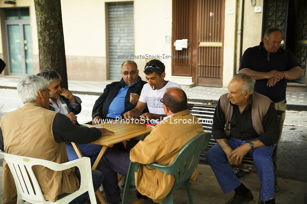 Italy, Sicily, Portrait of a group of local men in the village square