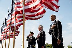 President Barack Obama, Defense Secretary Chuck Hagel, and Gen. Martin Dempsey, Chairman of the Joint Chiefs of Staff, listen to the national anthem during the September 11th Observance Ceremony at the Pentagon Memorial in Arlington, Va., Sept. 11, 2014. (Official White House Photo by Pete Souza)<br /> <br /> This official White House photograph is being made available only for publication by news organizations and/or for personal use printing by the subject(s) of the photograph. The photograph may not be manipulated in any way and may not be used in commercial or political materials, advertisements, emails, products, promotions that in any way suggests approval or endorsement of the President, the First Family, or the White House.